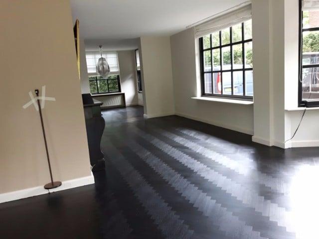 Onderhoud houten vloer schuren en lakken eindhoven